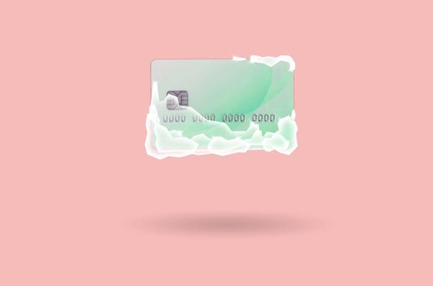 Carte de crédit verte gelée en blocs de glace blanche