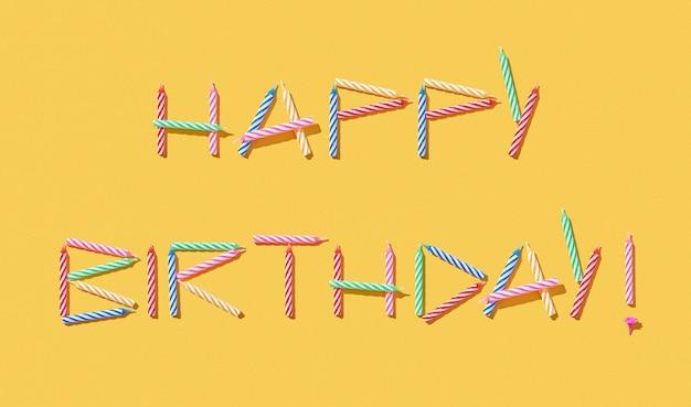 Carte de félicitations avec texte joyeux anniversaire à la main à partir de bougies multicolores