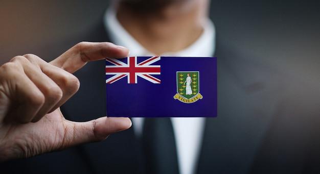 Carte de holding homme d'affaires du drapeau des îles vierges britanniques