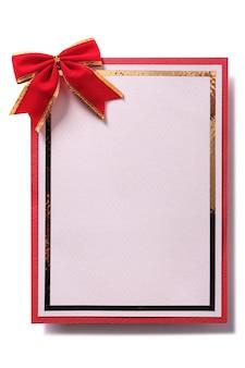 Carte de noël avec décoration arc rouge dans un cadre