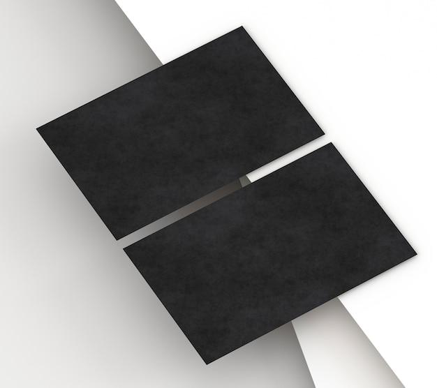Carte de visite noire de papeterie d'entreprise vierge sur papier