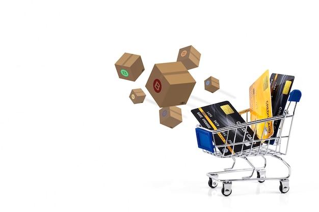 Cartes de crédit dans un panier d'achat isoler avec boîte-cadeau, concept de paiement en ligne commercial shopping