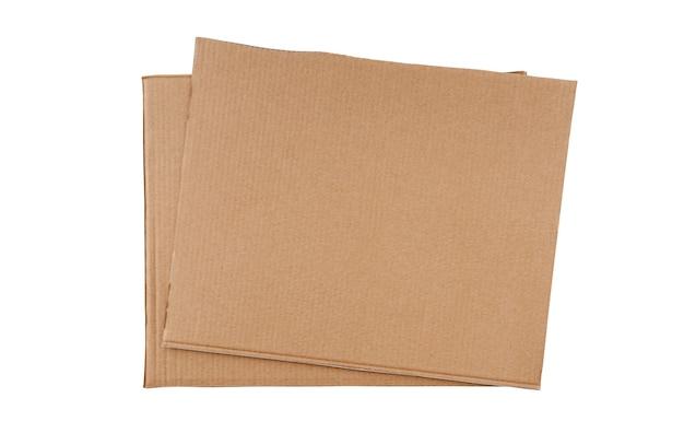 Carton foncé et lisse de grande taille et de forme rectangulaire en quantité de deux pièces empilées les unes sur les autres, isolées sur un fond blanc propre.