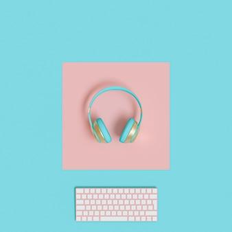 Casque audio et clavier d'ordinateur moderne or et bleu clair sur papier bicolore