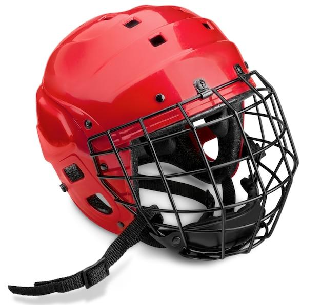 Casque de hockey sur glace rouge avec cage, isolé sur fond transparent