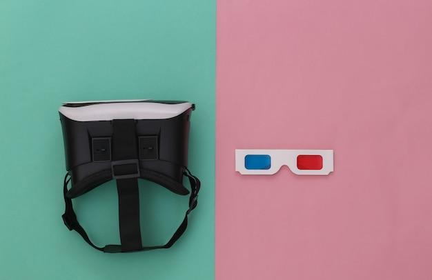 Casque de réalité virtuelle avec lunettes 3d sur fond bleu-rose. vue de dessus. flay jeter