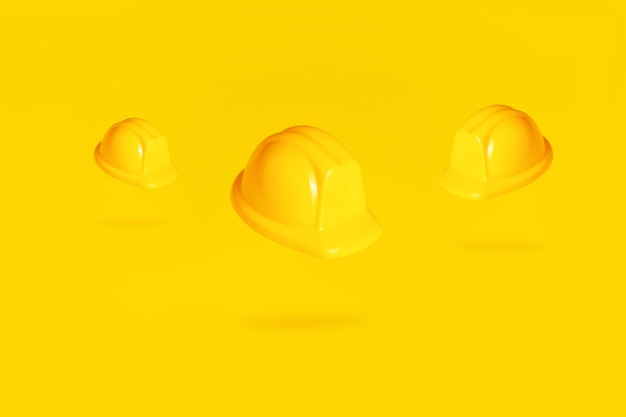 Casques en lévitation sur fond jaune, casques dans l'air sur fond jaune