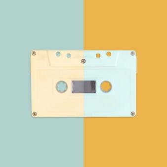 Cassette audio sur fond de couleur pastel.