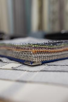 Catalogue de tissus échantillon de tissu. contexte de l'industrie