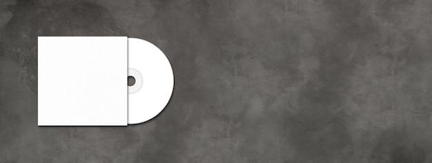 Cd blanc - étiquette de dvd et modèle de couverture isolé sur une bannière de béton horizontale