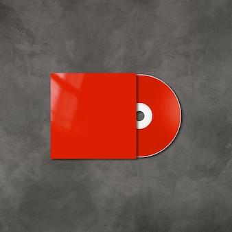 Cd rouge - étiquette de dvd et modèle de maquette de couverture isolé sur béton
