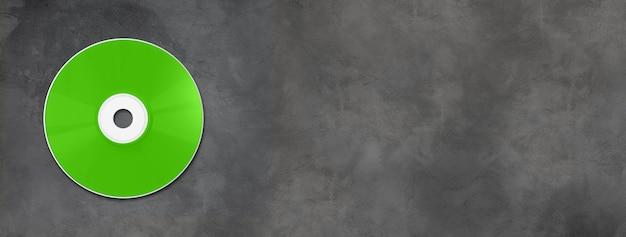 Cd vert - modèle de maquette d'étiquette dvd isolé sur une bannière de béton horizontale
