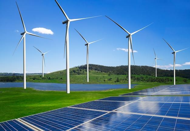 Cellule photovoltaïque de panneau d'énergie solaire et générateur d'énergie de ferme d'éolienne dans le paysage naturel.