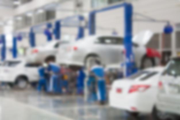 Centre de service de réparation automobile arrière-plan flou