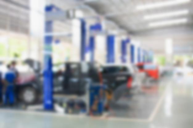 Centre de service de réparation de voiture arrière-plan flou