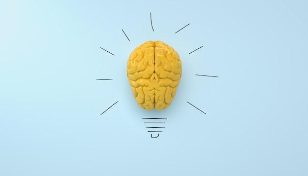 Cerveau jaune sur fond bleu clair, idée d'ampoule de concept avec dessin au crayon.