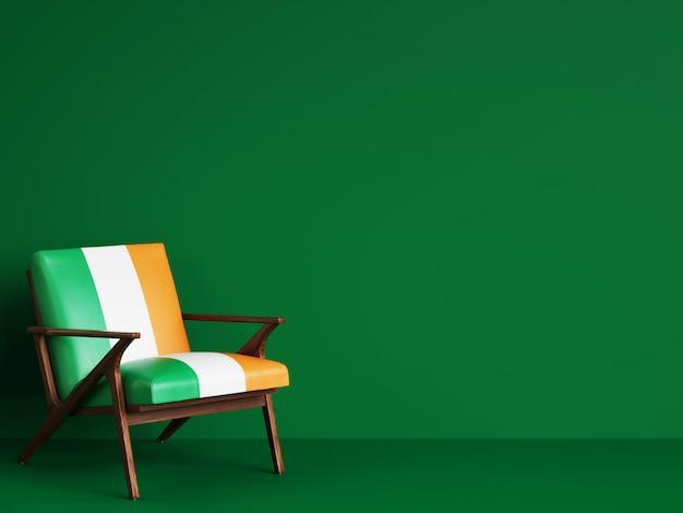 Chaise en couleur du drapeau irlandais sur mur vert avec espace copie. rendu 3d