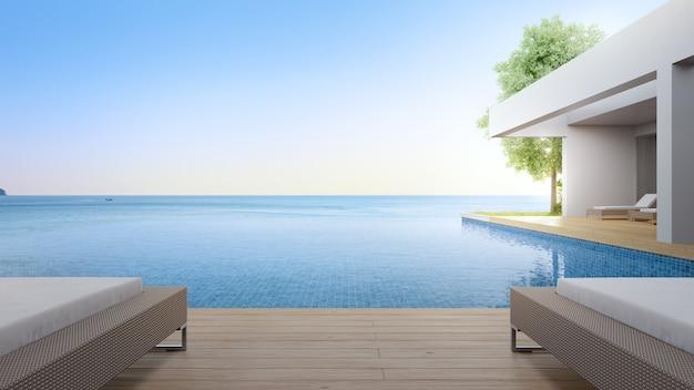 Chaise longue sur terrasse près de la piscine