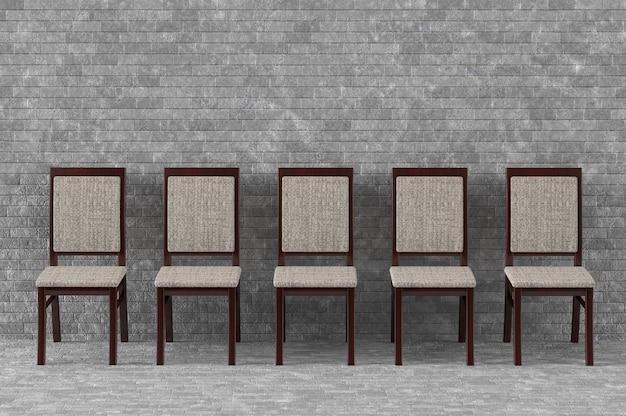 Chaises en bois modernes devant le mur de briques
