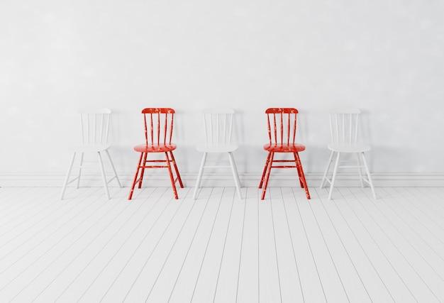 Chaises rouges et chaise blanche dans une salle blanche pour la distance physique