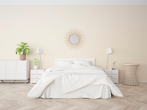 Chambre beige avec grand lit blanc décoration en rotin