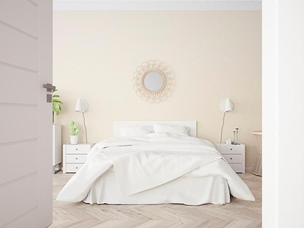 Chambre beige avec literie blanche