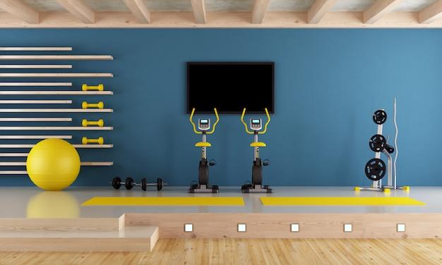 Chambre bleue avec équipement de gym