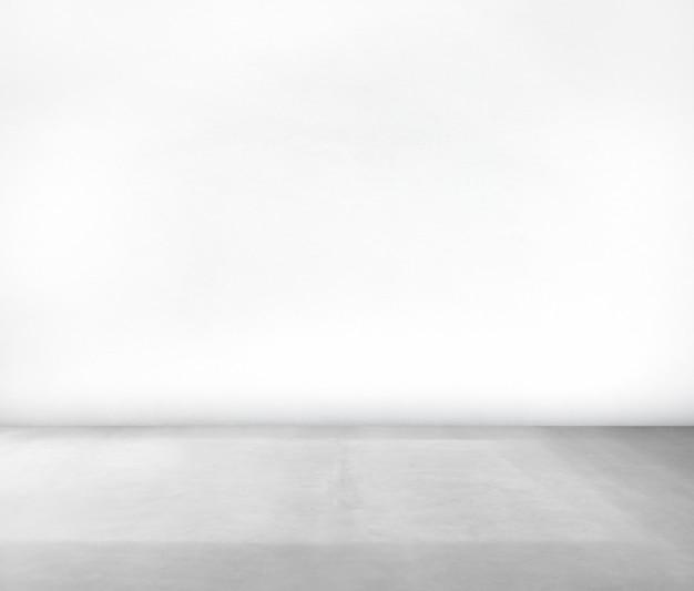 Chambre faite de mur blanc et sol en béton