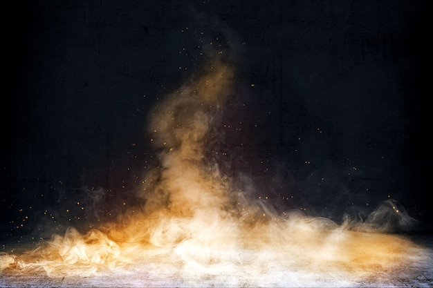 Chambre avec sol en béton et fumée avec fond d'étincelles de feu