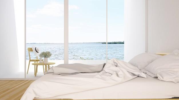 Chambre et terrasse vue lac dans hôtel ou condominium