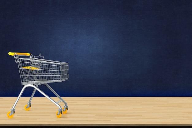 Chariot sur la table en bois avec toile de fond de tableau noir. e-commerce, concept de magasinage en ligne.