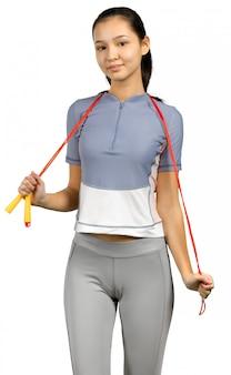 Charmante femme tenant une corde à sauter