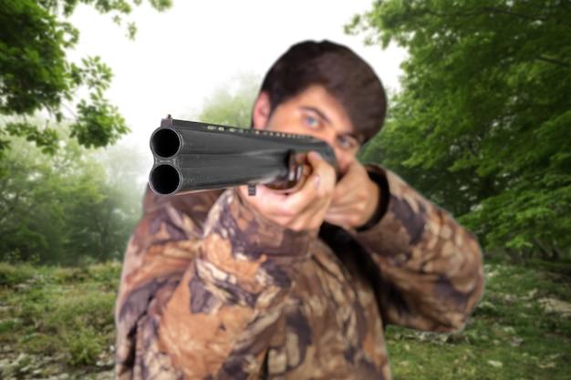 Chasseur avec son fusil