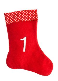 Chaussette de noël rouge pour les cadeaux sur fond blanc. stockage. symbole de l'avent