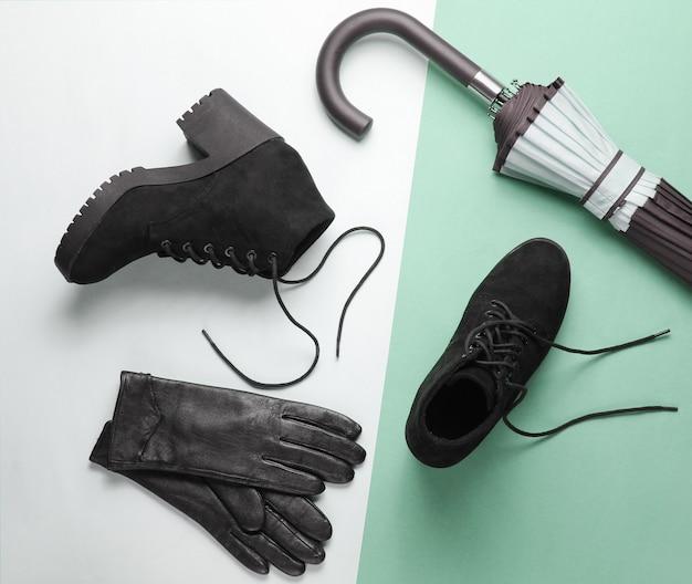 Chaussures et accessoires pour femmes à la mode sur fond de papier. bottes noires, gants en cuir, parapluie. vue de dessus