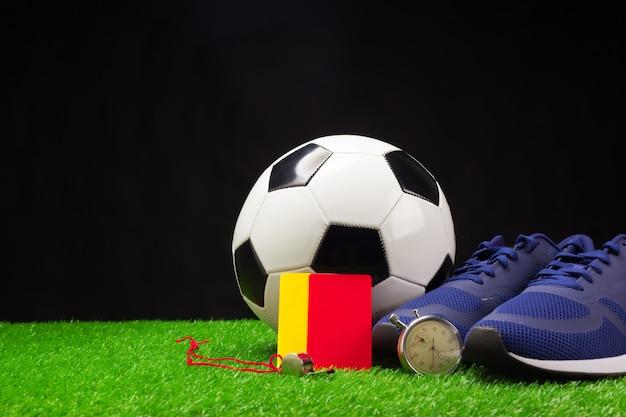 Chaussures de football et balle