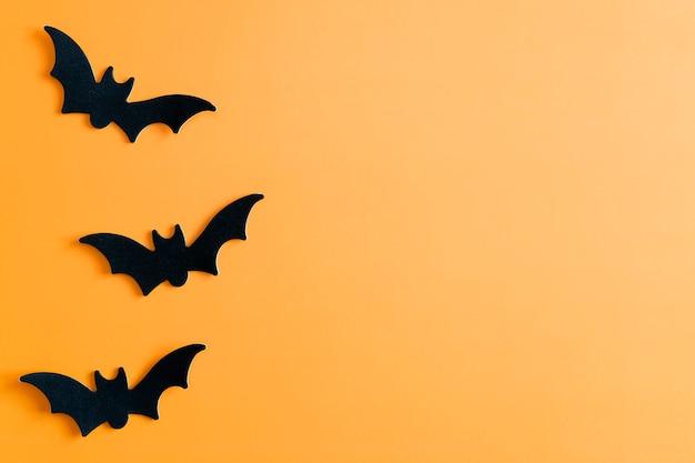 Chauves-souris d'halloween sur fond orange