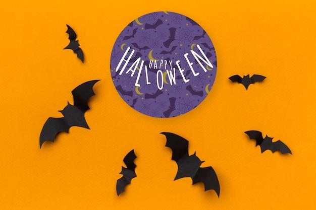 Chauves-souris en papier concept halloween sur fond orange
