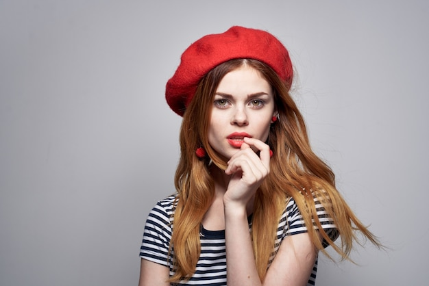 Cheerful woman wearing a red hat maquillage france europe fashion posing summer
