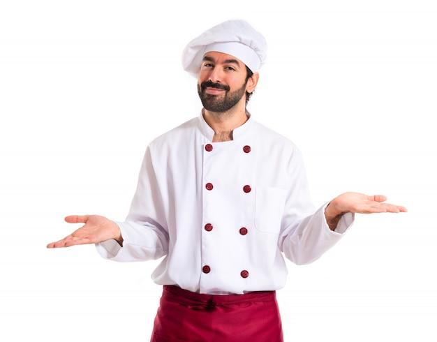 Chef ayant des doutes sur fond blanc