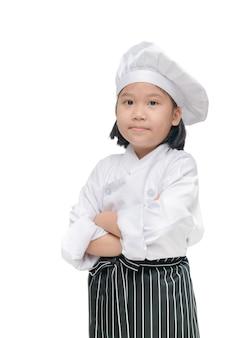 Chef de jolie fille avec chapeau de cuisinier et tablier isolé
