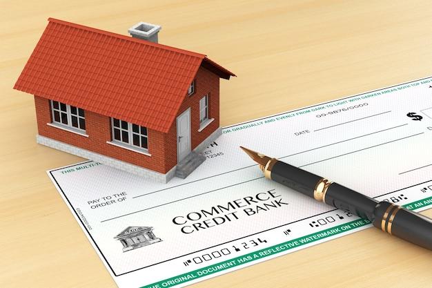 Chèque bancaire avec maison et stylo sur la table