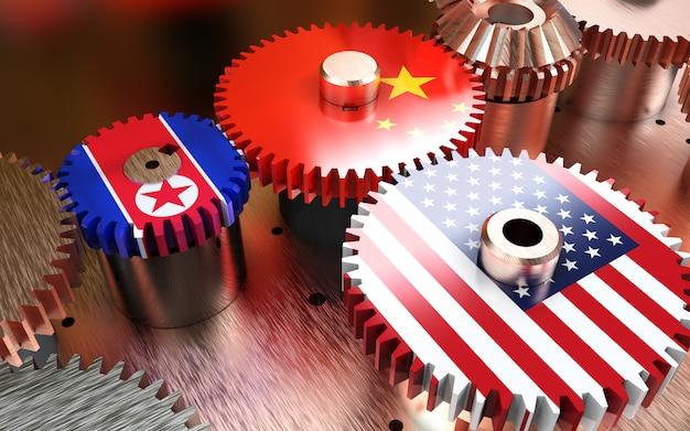 La chine et les états-unis drapeaux sur les engrenages en métal.