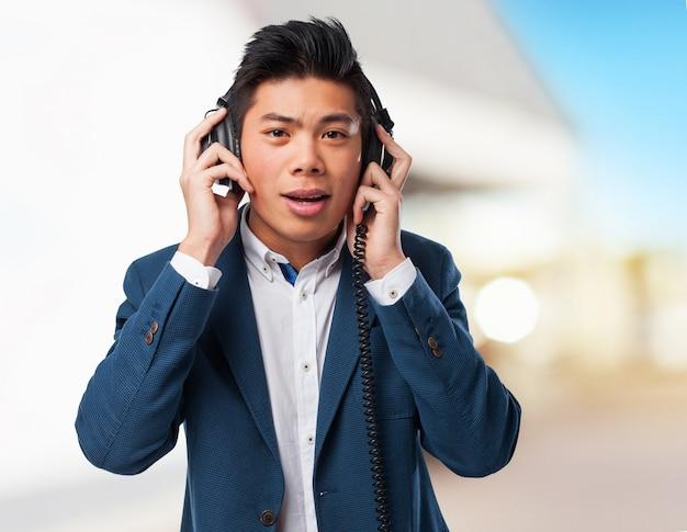 Chinese man listening music