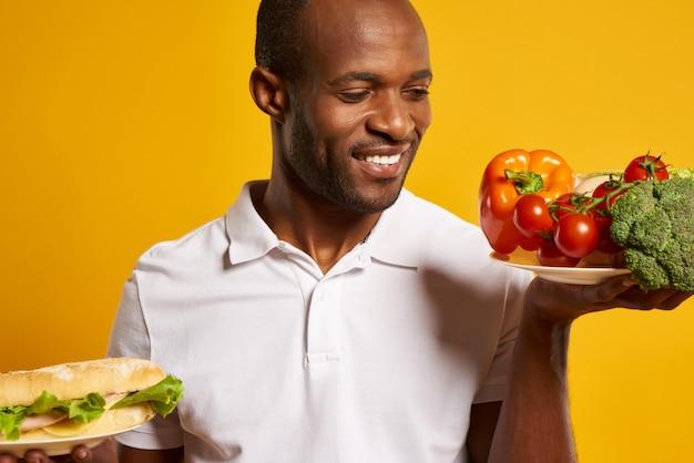 Choix de l'homme entre des aliments sains et nocifs.