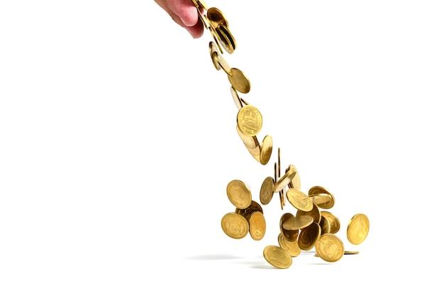 Chute de pièces d'or d'argent isolé