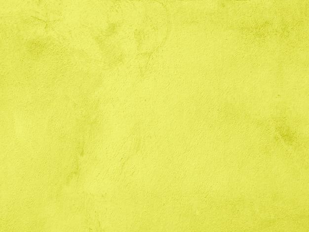 Ciment de couleur jaune et texture béton pour fond abstrait.