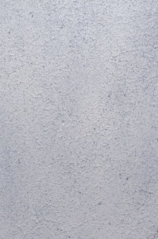 Ciment gris stuc, teinté inégale, fond de texture.