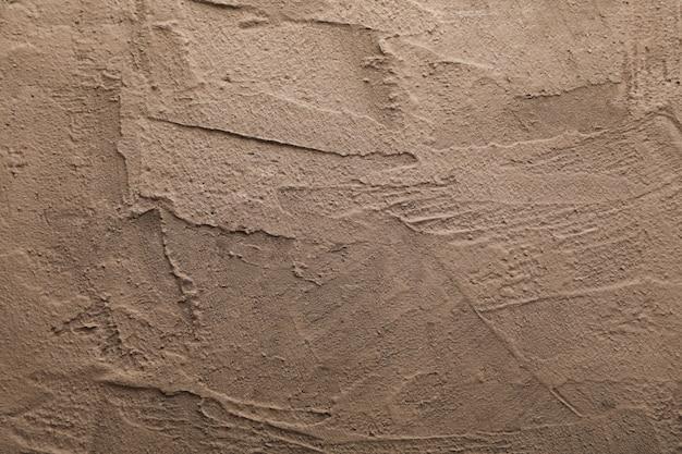Ciment mural à surface rugueuse.