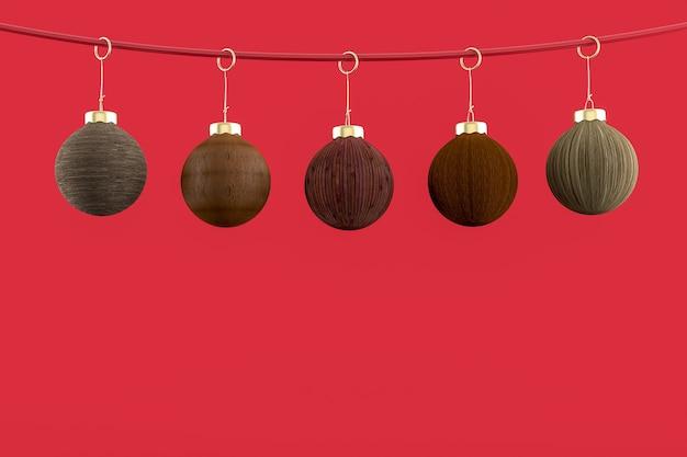 Cinq boules de noël suspendues avec un fond rouge. concept de joyeux noël